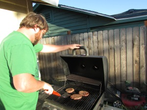 Son cooking up burgers